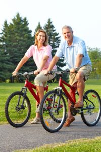 senior couple biking